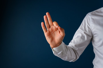 Hand of a businessman making an ok or excellent hand sign