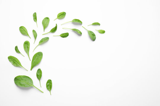 Fresh green healthy spinach on white background, top view