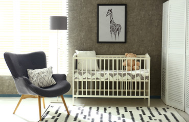 Cozy baby room interior with comfortable crib