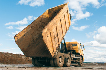 Old dump truck at a construction site. Equipment for construction.