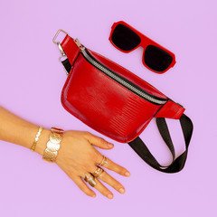 Fashion red clutch and stylish gold jewelry. Sunglasses. Trends Lady Accessories