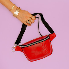 Fashion red clutch and stylish gold jewelry. Trends Lady Accessories