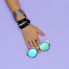 Stylish accessories swag jewelry and sunglasses.