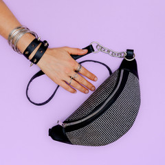Stylish accessories clutch and jewelry. Swag agressive clubbing style