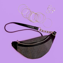 Stylish lady clutch and swag jewelry . Trendy Accessories flat lay fashion concept
