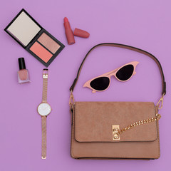 Fashion beige lady clutch bag and accessories. Trend cosmetics.