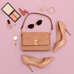 Fashion beige lady clutch bag, shoes and accessories. Trend cosmetics.  Stylish look