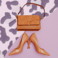 Fashion beige lady clutch and high heel shoes. Trendy flat lay look