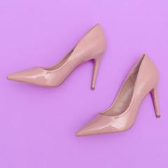 Stylish beige high heel shoes. Flat lay fashion art