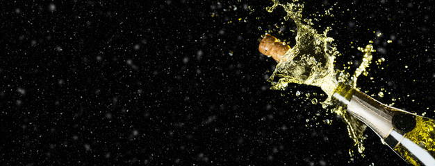 Celebration theme with splashing champagne on black background with snow and free space. Christmas or New Year, Valentines day background. Wide banner format party mockup.