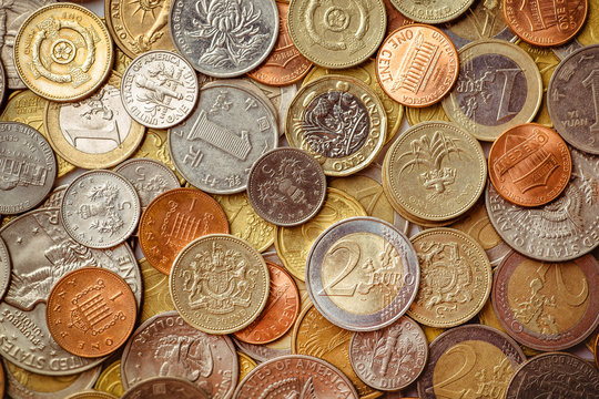 Background of Euro coins money.United kingdom Pound coin.US coins.Group of coins