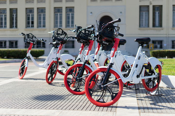 City bicycle Thessaloniki parked electric bikes on the sidewalk ready for rent rental bikes services sharing service
