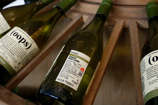 Wines with Huawei logo on the label are displayed for sale at a Huawei Mossel shop in Huawei's headquarters in Shenzhen, Guangdong