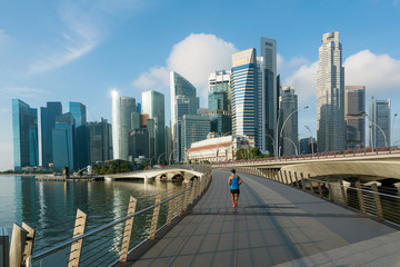 People jogging at morning in Singapore business district skyline financial downtown building with tourist sightseeing in day at Marina Bay, Singapore. Asian tourism, modern city life