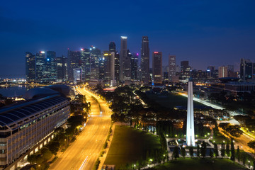 Panorama of Singapore business district skyline and skyscraper with War Memorial Park in night at Marina Bay, Singapore. Asia,