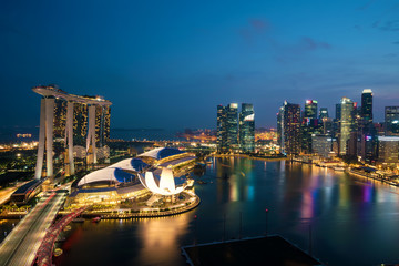 Panorama of Singapore business district skyline and Singapore skyscraper in night at Marina Bay, Singapore.