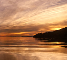 Yellow colored cirrus cloud, sunset seascape.