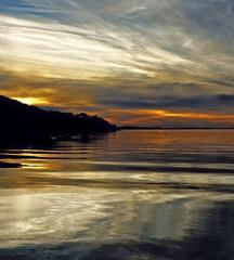 White colored cirrus cloud, sunset seascape.