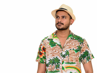 Young handsome Indian man ready for vacation thinking