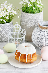 Traditional Easter cake, colorful eggs and floral decoration of the table.