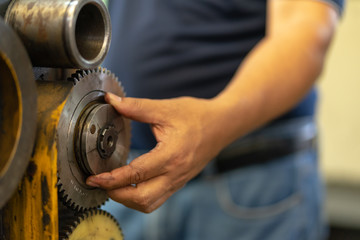 Preventive machine maintenance and retrofit in machine shop.Spindle shaft gear and bearing, parts in head stock of lathe machine.