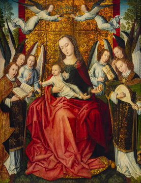 Lens, France. 2019/9/14. Virgin Mary with Infant Jesus surrounded by angels singing and playing instruments. The Louvre Museum in Lens, France.