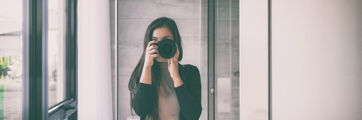 Selfie self-portrait in home mirror young woman taking self photo with slr camera panorama banner background. House lifestyle.