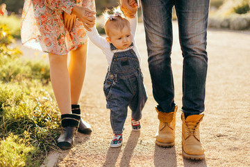 Happy family father, mother and child daughter outdoor  enjoying  sunset  - Image