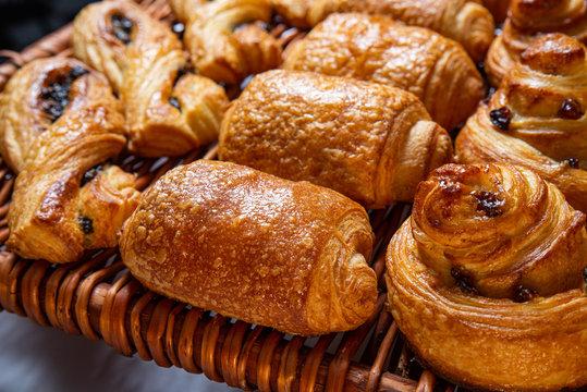 Freshly baked cinnamon buns. Sweet Homemade Pastry baking. Close-up
