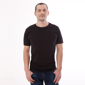 Men's Blank Black T-Shirt Apparel Mockup Bella Canvas Front. Shirt Mock Up Clothes. Young man in blank black tshirt front isolated. Mock up template for design print