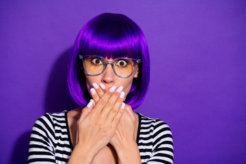 Photo of beautiful lady made mistake and fail hide open mouth by hands wear wig striped pullover isolated purple background