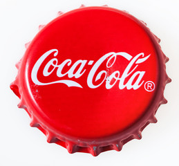 MOSCOW, RUSSIA - DECEMBER 12, 2105: top view of used red cap from the glass bottle of Coca-Cola. The Coca-Cola Company is an American beverage corporation and manufacturer founded in 1886.