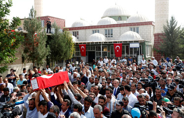 People carry the Turkish flag-wrapped coffin of 9-month-old baby boy Mohammed Omar Saar during a funeral ceremony in the border town of Akcakale