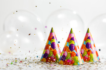 confetti and party hat. party background with copy space