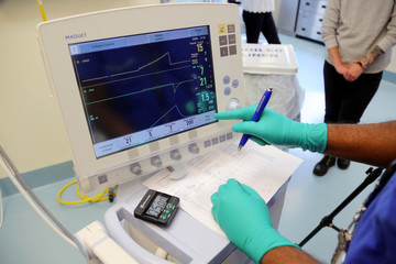 Aadil Ali runs a test on a pig's lung being inflated at a lab run by the University Health Network in Toronto