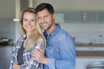 Portrait of cheerful middle-aged couple at home