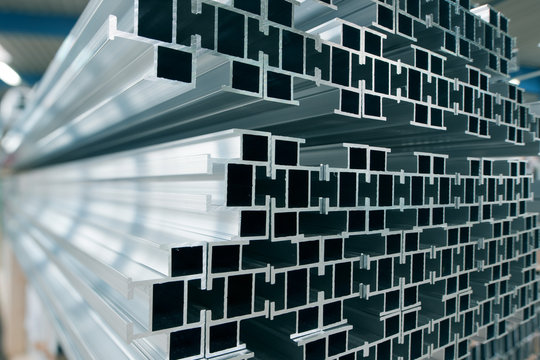 Aluminium Profiles stacked in a storage rack.