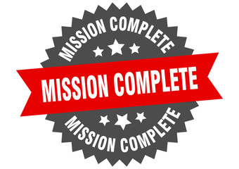mission complete sign. mission complete red-black circular band label