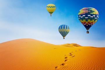 Poster Ballon Desert and hot air balloon Landscape at Sunrise. Travel, inspiration, success, dream, flight concept