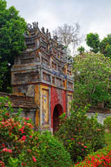 Colorful gate between two areas inside of Purple Forbidden city (Imperial Citadel) in Hue, Vietnam