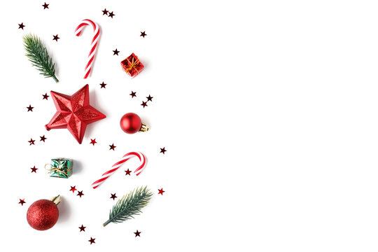 Christmas Red decorations, fir tree branches on white background.