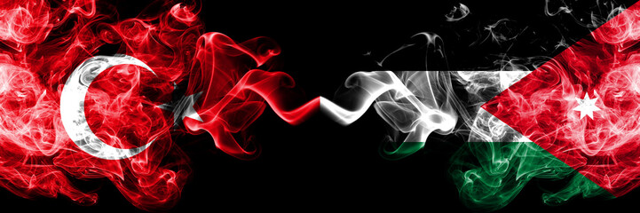 Turkey vs Jordan, Jordanian smoke flags placed side by side. Thick colored silky smoke flags of Turkish and Jordan, Jordanian