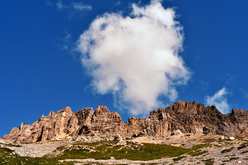 jumps towards the refuge path tower of Pisa latemar (predazzo pampeago) dolomites alto adige Italy