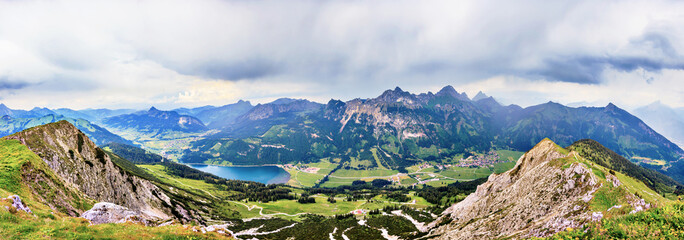 Panoramic picture over the Tannheimer valley in Austria with view over Halden lake and Krinnenspitze summit