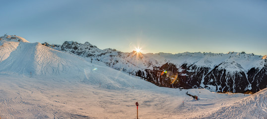 Panorama picture of the Montafon skiing area in Austria with blue sky at daytime