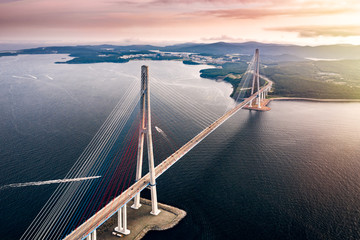 Aerial view of the Russky Bridge from Vladivostok city to Russky Island over the Strait of Eastern Bosphorus. Cable-stayed bridge in Primorsky Krai, Far East, Russia