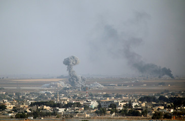 Smoke rises over the Syrian town of Ras al-Ain, as seen from the Turkish border town of Ceylanpinar