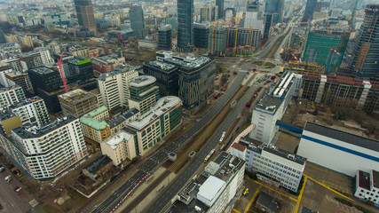 Foto op Plexiglas New York Aerial view of the Warsaw cityscape with skyscrapers and buildings in the capital of Poland. 05. October. 2019. Panorama of the city on a cloudy day.
