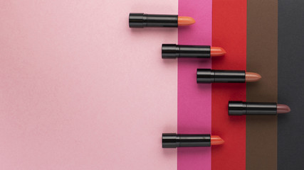 Top view of lipstick shades on plain background Wall mural