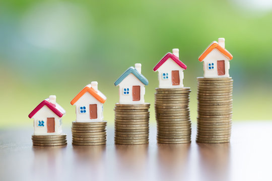 House on the coin, arranged from low to high Concept of starting a business Mortgages and real estate investments Investment for profit